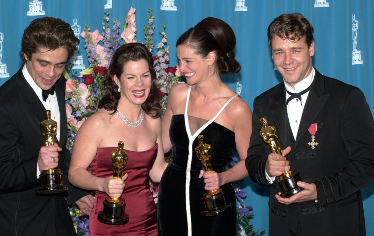 Oscar 2001. Benicio Del Toro, Marcia Gay Harden, Julia Roberts and Russell Crowe. Photo by Shutterstock.