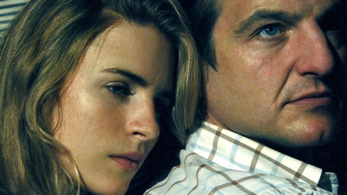 Brit Marling and William Mapother in a scene of the movie